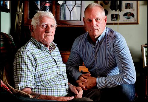 Richard Lowndes in his Kilsallaghan Co Dublin home alongside his son Graham Lowndes. Pic Steve Humphreys