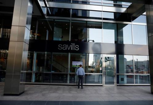 A man looks at offers at an Savills office at Canary Wharf in London, Britain October 30, 2015. REUTERS/Reinhard Krause