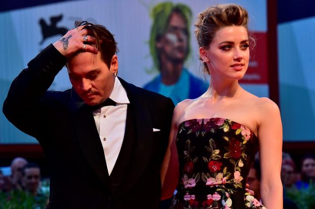 US actress Amber Heard arrives with US actor Johnny Depp for the screening of the movie
