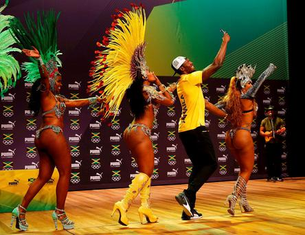 2016 Rio Olympics - Athletics - Rio de Janeiro, Brazil - 08/08/2016. Usain Bolt dances samba at a press conference. REUTERS/Nacho Doce FOR EDITORIAL USE ONLY. NOT FOR SALE FOR MARKETING OR ADVERTISING CAMPAIGNS