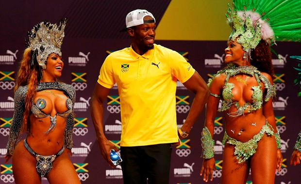 2016 Rio Olympics - Athletics - Rio de Janeiro, Brazil - 08/08/2016. Usain Bolt dances samba at a press conference. REUTERS/Nacho Doce TPX IMAGES OF THE DAY
