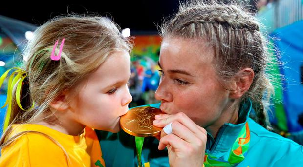Nicole Beck of Australia kisses her Gold medal with her daughter Sophie Beck after the medal ceremony for the Women's Rugby Sevens on Day 3 of the Rio 2016 Olympic Games at the Deodoro Stadium on August 8, 2016 in Rio de Janeiro, Brazil. (Photo by Alexander Hassenstein/Getty Images)