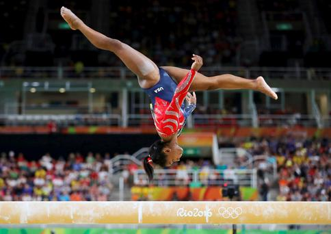 Simone Biles (USA) of USA competes on the beam during the women's qualifications at Rio