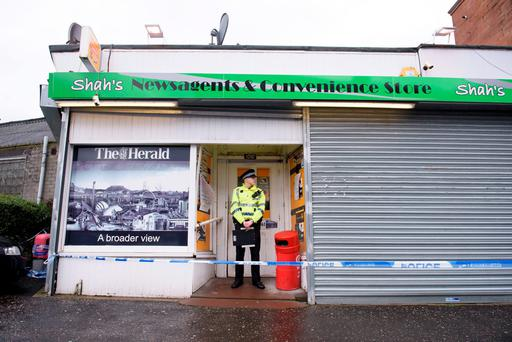 The shop where murder victim Asad Shah worked in Shawlands, Glasgow Credit: John Linton/PA Wire