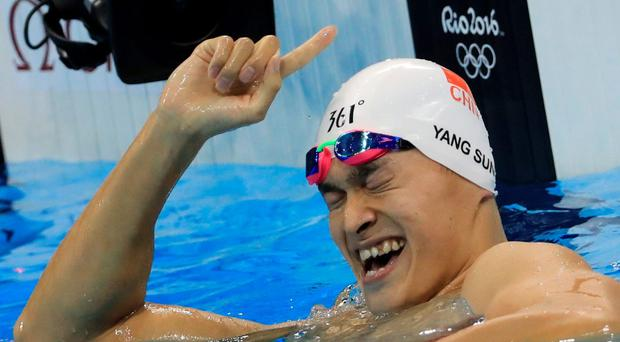 Sun Yang celebrates winning 200m freestyle gold. Reuters