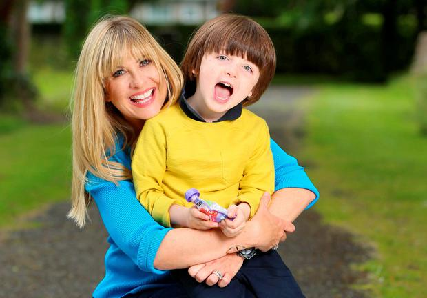 Laura Woods and her son Ben at the launch of Yoplait's new Petits Filous Pouches. Picture: Marc O'Sullivan
