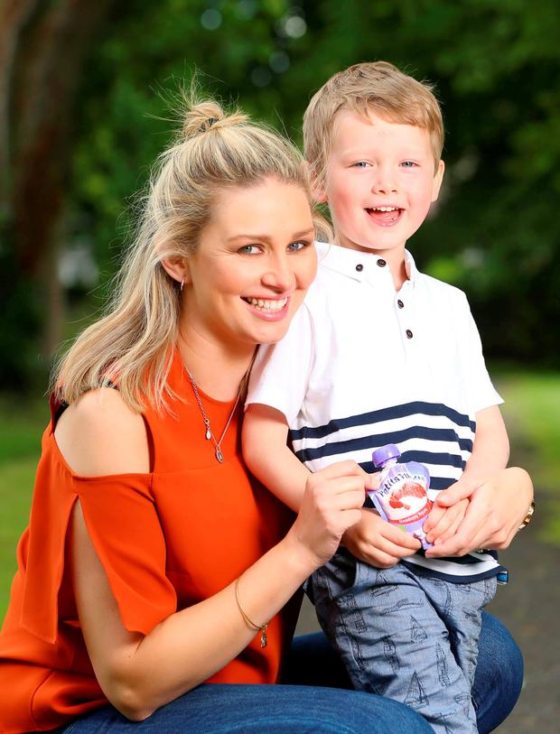Anna Daly and her son James at the launch of Yoplait's new Petits Filous Pouches. Picture: Marc O'Sullivan