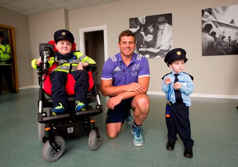 Garda Ceejay McArdle and Garda Jordan Perez with Munster and Irelands CJ Stander.