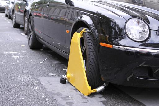 Private clampers are still able to charge up to €300 to release vehicles despite new laws to limit fees being passed 15 months ago. Stock Image