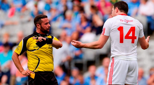 David Gough shows his first yellow card to Seán Cavanagh, whom Tyrone boss Mickey Harte claimed was 'targeted'. Photo: Sportsfile