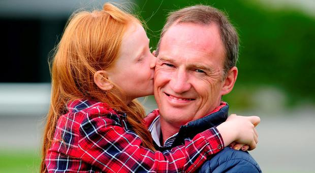 Paul Carberry with his daughter Kasey Lou yesterday after he announced he was retiring. Photo: Healy Racing