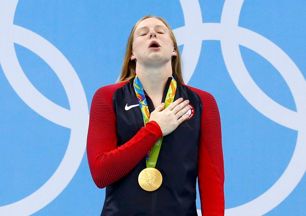 Lilly King of the USA poses with her gold medal. Photo: Reuters