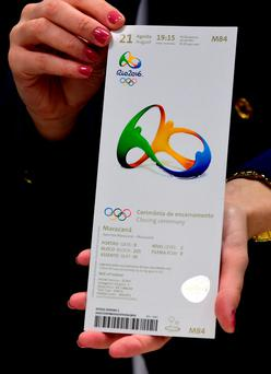 A Brazilian official shows one of the tickets referring to the National Olympic Council of Ireland that was allegedly seized from Kevin Mallon. Getty Images