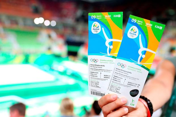 A member of the crowd shows their tickets for the gymnastics at the Rio Olympic Arena. Photo: Martin Rickett/PA Wire