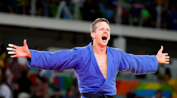 Belgium's Dirk Van Tichelt celebrates after winning a bronze medal in the men's 73-kg judo competition at at the 2016 Summer Olympics in Rio de Janeiro, Brazil, Monday, Aug. 8, 2016. (AP Photo/Markus Schreiber)