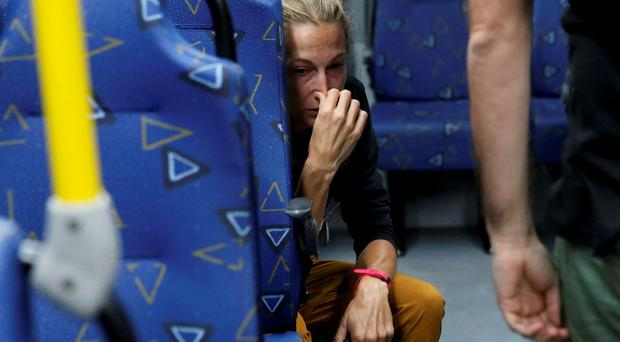 Journalist Joanna Moyse cries on an official media bus after a window shattered when driving accredited journalists to the Main Transport Mall from the Deodoro venue of the Rio 2016 Olympic Games in Rio de Janeiro, August 9, 2016. REUTERS/Shannon Stapleton