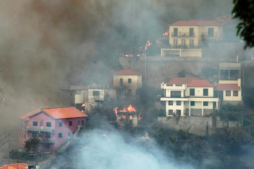 A general view of Sitio de Curral dos Romeiros during the wildfires at Funchal, Madeira island, Portugal, August 9, 2016. REUTERS/Duarte Sa