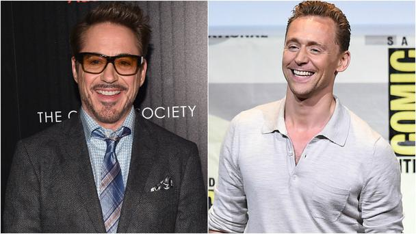 Robert Downey Jr has playfully roasted Tom Hiddleston over the now infamous Taylor Swift vest. Photo: Getty