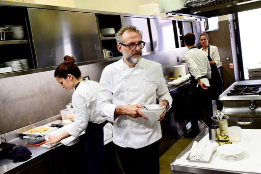 Italian chef Massimo Bottura working in the kitchen of his restaurant 'Osteria Francescana' in Modena