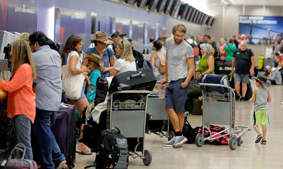 Delta passengers stand in line as the carrier slogged through day two of its recovery from a global computer outage Tuesday, Aug. 9, 2016, in Salt Lake City
