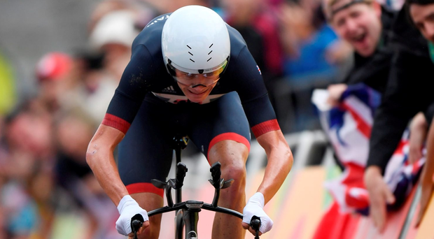Britain's Christopher Froome crosses the finish line to take bronze in the Men's Individual Time Trial event at the Rio 2016 Olympic Games in Rio de Janeiro on August 10, 2016. / AFP PHOTO / Eric FEFERBERGERIC FEFERBERG/AFP/Getty Images