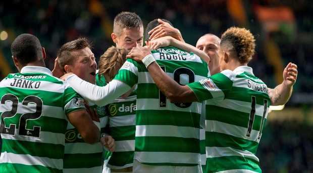 Celtic's Tom Rogic celebrates scoring his side's first goal of the game with team-mates during the Betfred Cup match at Celtic Park, Glasgow. PRESS ASSOCIATION