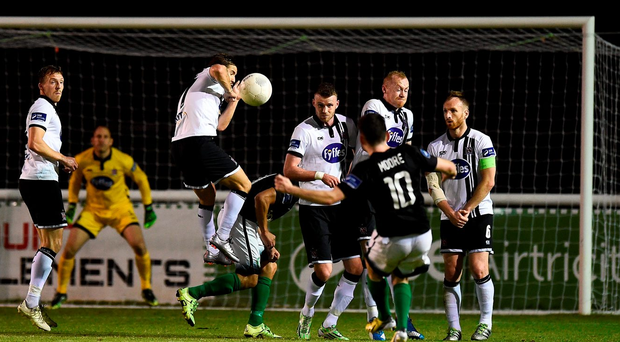Karl Moore scores the winner for Bray Wanderers as the Dundalk wall falls asunder. Photo: David Maher/Sportsfile