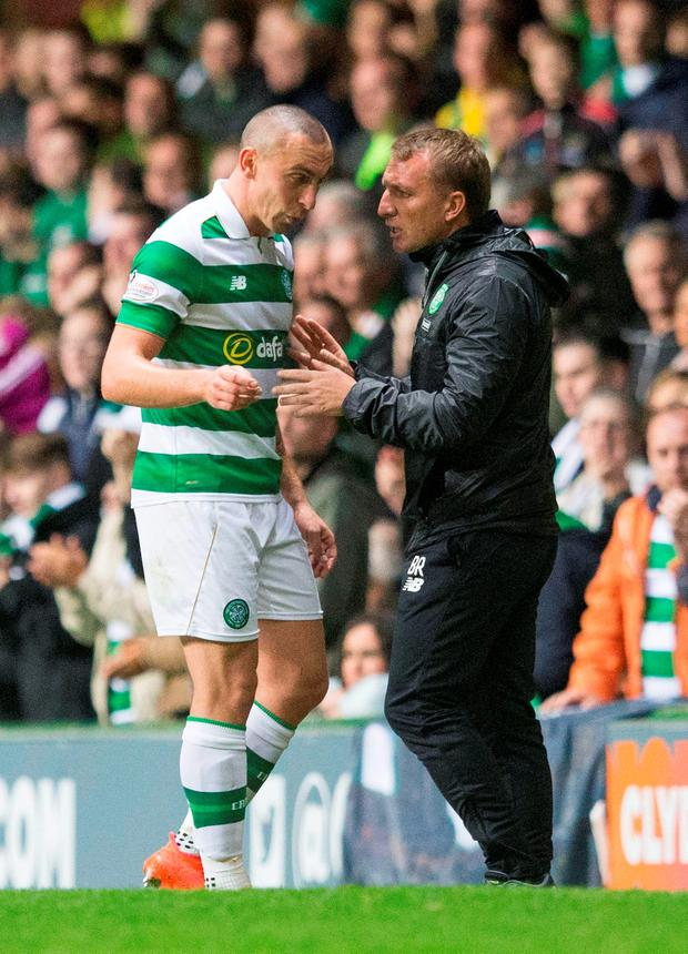 Celtic's Scott Brown shares a joke with manager Brendan Rodgers. Photo: Jeff Holmes/PA Wire