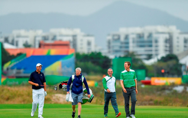Padraig Harrington of Ireland with team-mate Seamus Power, right, caddy Ronan Flood and Team Ireland captain Paul McGinley