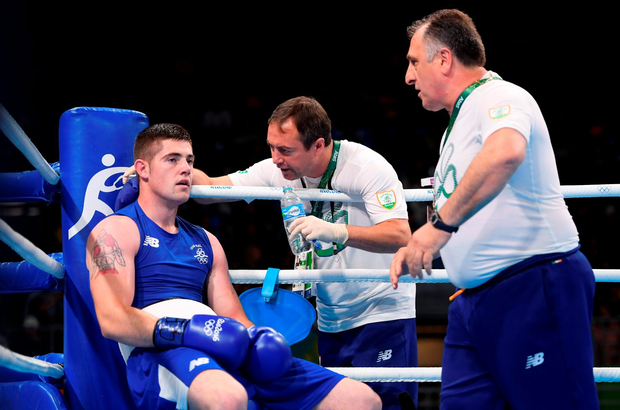 Team Ireland coaches Eddie Bolger, centre, and Zaur Antia speak with Joe Ward