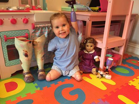 Harmonie Rose (2) had all four limbs amputated in a battle against meningitis B when she was 10 months old. Here she is pictured with her doll Becca. Photo: Facebook