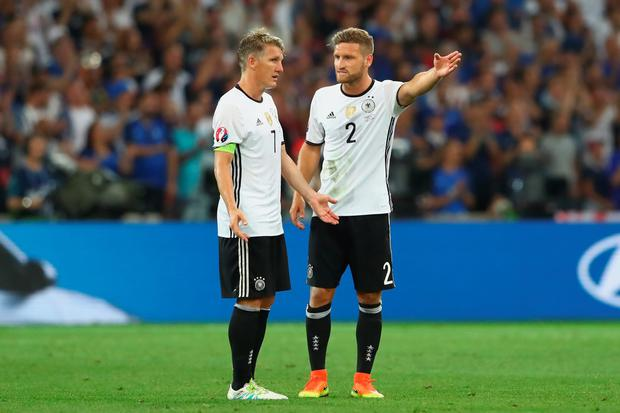 Bastian Schweinsteiger (L) of Gerrmany reacts with his team mate Shkodran Mustafi during Euro 2016