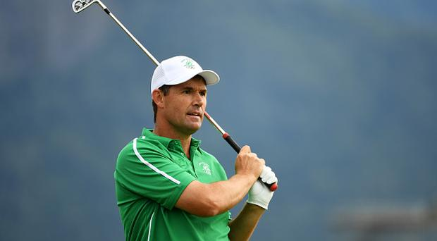 RIO DE JANEIRO, BRAZIL - AUGUST 11: Padraig Harrington of Ireland plays his shot from the fourth tee during the first round of men's golf on Day 6 of the Rio 2016 Olympics at the Olympic Golf Course on August 12, 2016 in Rio de Janeiro, Brazil. (Photo by Ross Kinnaird/Getty Images)
