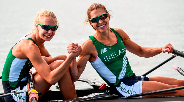 Claire Lambe and Sinead Lynch celebrate after clinching their place in the final of the women's lightweight double sculls. Photo: Stephen McCarthy/Sportsfile