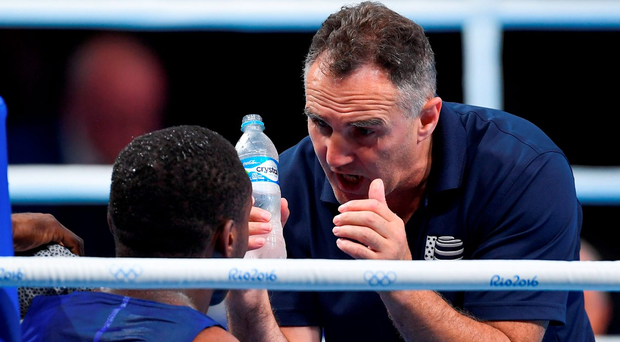 Billy Walsh gives instructions to Charles Albert Conwell during the men's middleweight preliminaries this week. Photo by Ramsey Cardy/Sportsfile