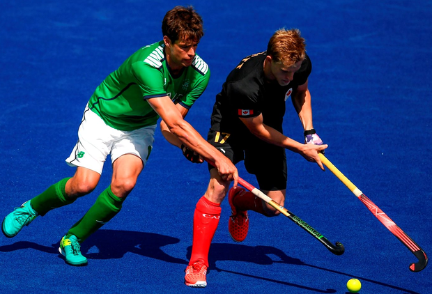 John Jermyn of Ireland in action against Brenden Bissett of Canada. Photo: Stephen McCarthy/Sportsfile