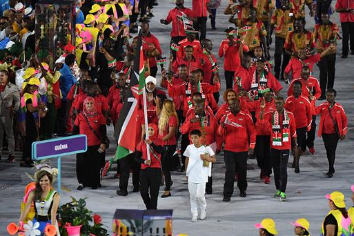Kenya's flagbearer Shehzana Anwar leads her delegation during the opening ceremony of the Rio 2016 Olympic Games at the Maracana stadium in Rio de Janeiro on August 5, 2016. / AFP / PEDRO UGARTE (Photo credit should read PEDRO UGARTE/AFP/Getty Images)