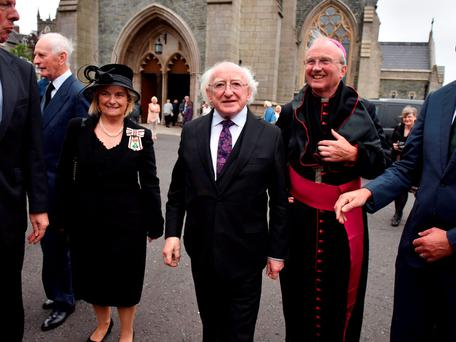 President Michael D Higgins alongside Bishop Donal McKeown at the funeral of Bishop Daly in Derry. Photo: Getty