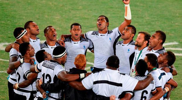 Fiji's players pray after winning the mens rugby sevens gold medal