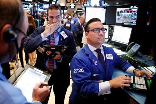 Traders work on the floor of the New York Stock Exchange (NYSE) shortly after the opening bell in New York, U.S., August 9, 2016. REUTERS/Lucas Jackson