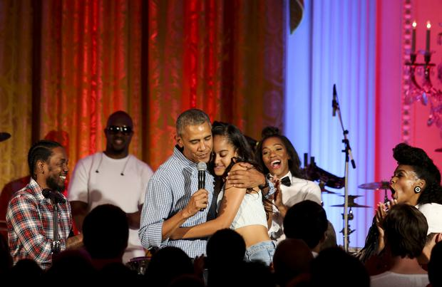 President Barack Obama hugs his daughter Malia Obama at the Fourth of July White House party on July 4, 2016 in Washington, DC. Maila Obama celebrated her 18th birthday during the party, which featured guests including singers Janelle Monae and Kendrick Lamar. (Photo by Aude Guerrucci-Pool/Getty Images)
