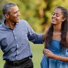 U.S. President Barack Obama and daughter Malia. (Photo by Olivier Douliery-Pool/Getty Images)