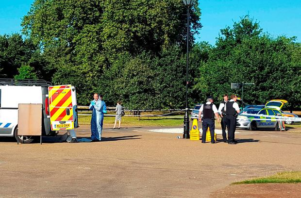 Police at the scene in Hyde Park, London, after a body was discovered.