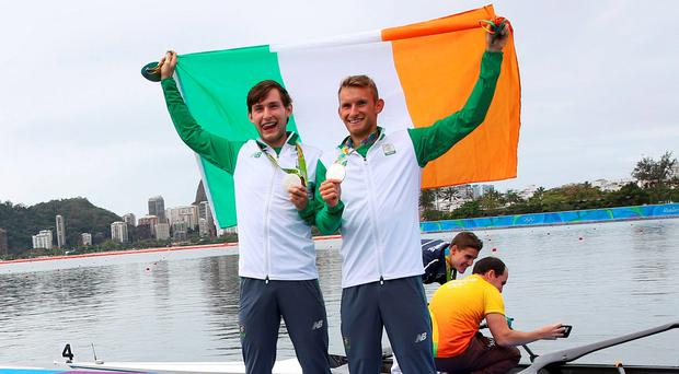 Silver medalists Gary O'Donovan (IRL) of Ireland and PaulO'Donovan (IRL) of Ireland pose with their medals and flag
