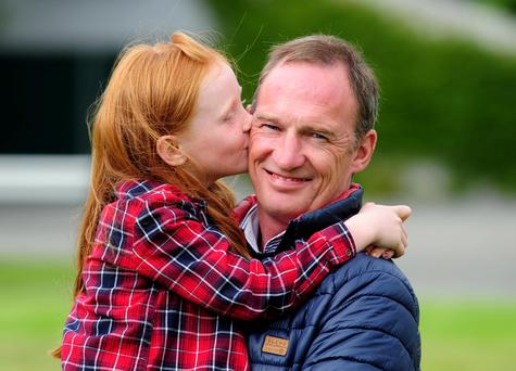 Paul Carberry with his daughter Kasey Lou after announcing his retirement. Picture Credit: Healy Racing