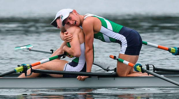 Brothers Gary and Paul O'Donovan embrace after finishing second in the men's lightweight double sculls in Rio yesterday. Photo: Sportsfile