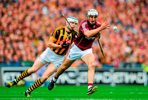 Daithi Burke in action against TJ Reid of Kilkenny last year. Photo: Sportsfile