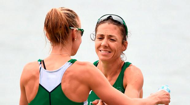Sinead Lynch (R) and Claire Lambe embrace after the final. Sportsfile