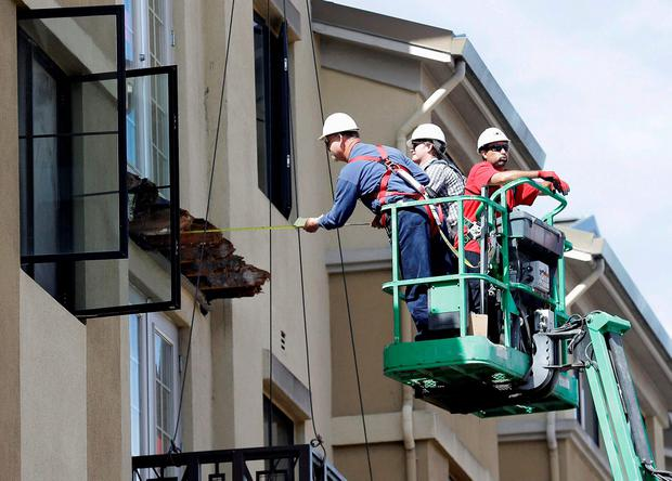 Workmen inspect the Berkeley balcony after the tragedy Picture: AP