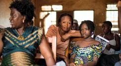 A mother and her daughter at a Goal-supported counselling session for survivors of Ebola in Kenema, Sierra Leone. Picture Credit: Mark Condren